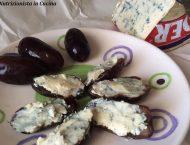piatto di datteri freschi aperti a metà e ripieni di gorgonzola